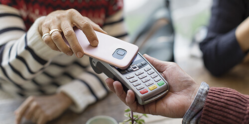 personal-mobile-phone-digital-wallet-payment-hands