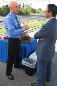 Agency Owner Calvin Bishop chats with member of Rutherford Chamber of Commerce