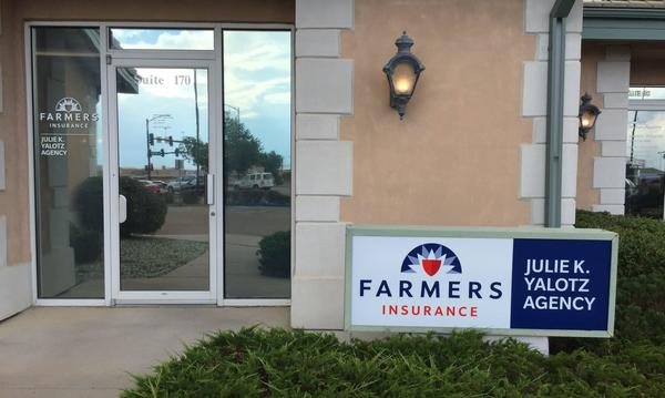 Agent Julie Yalotz's storefront with a Farmers sign next to the door.