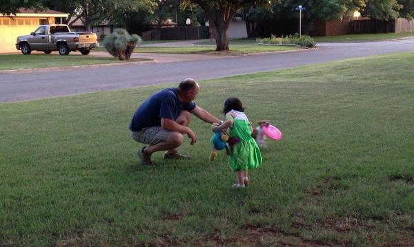 My granddaughter and I playing with Maggie.