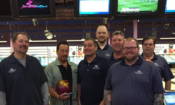 group of 7 men at a bowling tournament