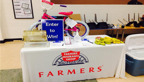 A pink bike on display on a Farmers table