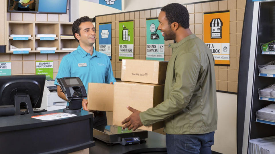 Customer dropping off packages to be shipped at front counter