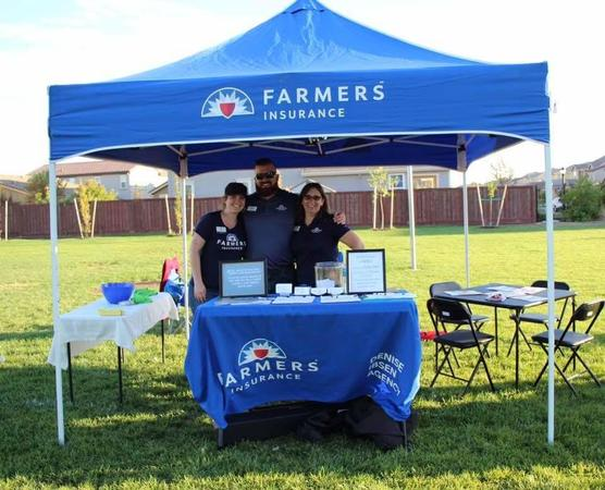 Group photo of the Ibsen Agency under a Farmers Insurance tent at Neighborhood Night Out 2018