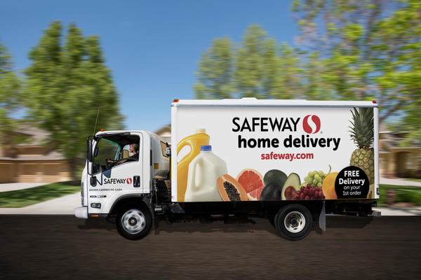 Safeway.com Delivery truck driving down the road.