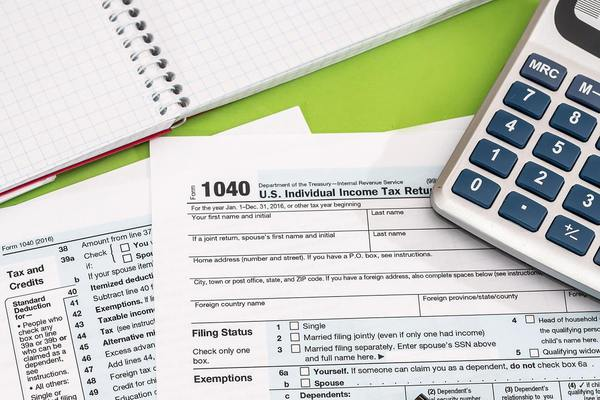 Tax return 1040 papers with calculator