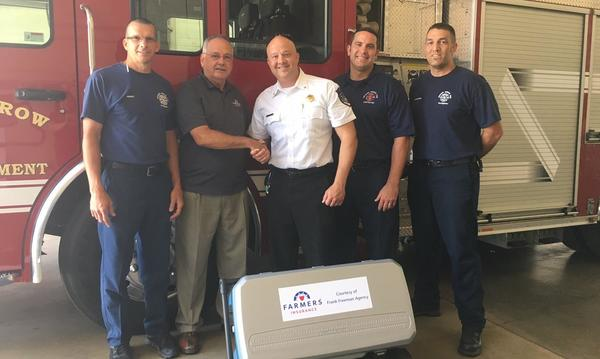 Frank donating an ice cooler to the fire department