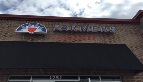 Insure the Ozarks representing Farmers® with the new logo!