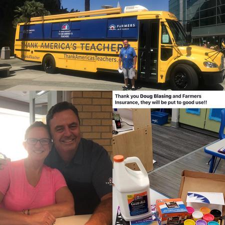 A school bus, two people posing together, and some school supplies