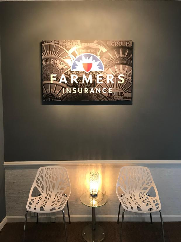 Farmers sign and two chairs by light