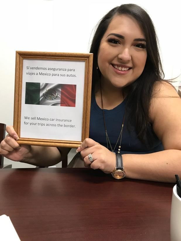 Woman holding a picture with the Mexican flag