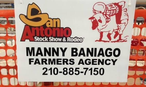 Sign advertising Manny Baniago's agency and the San Antonio Stock Show and Rodeo