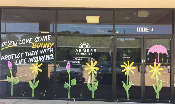 A photo of spring decorations on the Farmers agency windows.