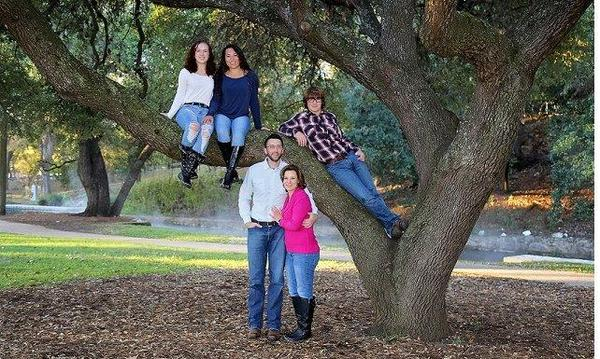 Family posing on tree branches