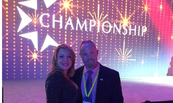 Agent Danielle and male staff member at Championship event
