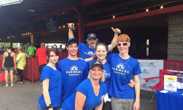 Agent Elaine Vidtelliott with her family wearing Farmers Insurance t-shirts at Kennywood Park.