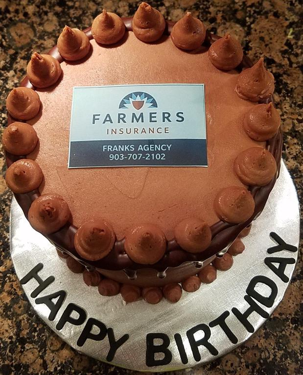Cake with Farmers Insurance logo on top