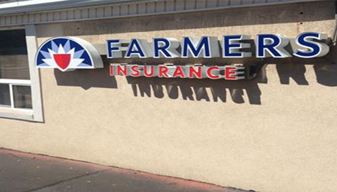 Farmers® Insurance new look can be seen from Holiday oil gas station in Tooele