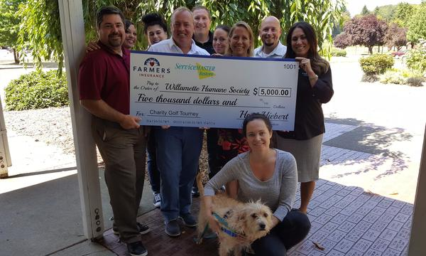 Check presentation to the Humane Society from Golf Classic Fundraiser 2016