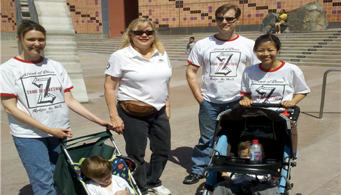 agent with three other adults and two babies in strollers