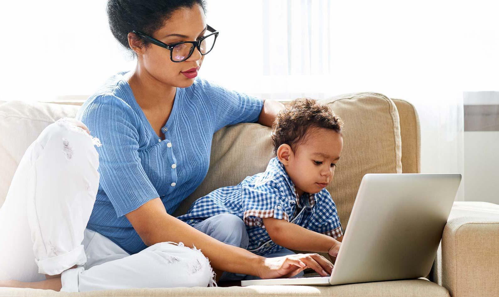 woman with baby on laptop