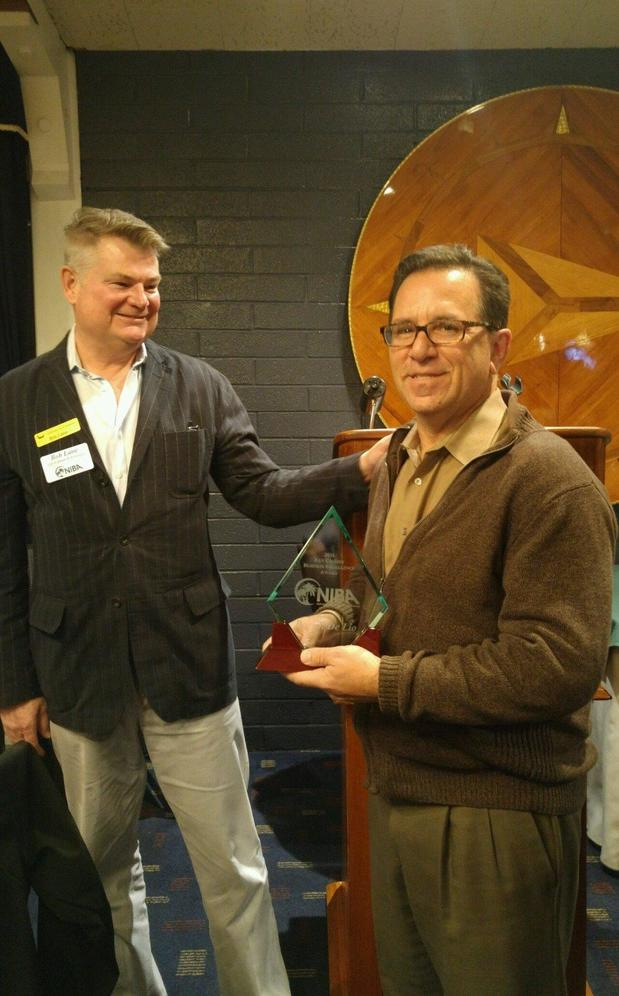 Receiving the Ken Cassidy Business Excellence Award