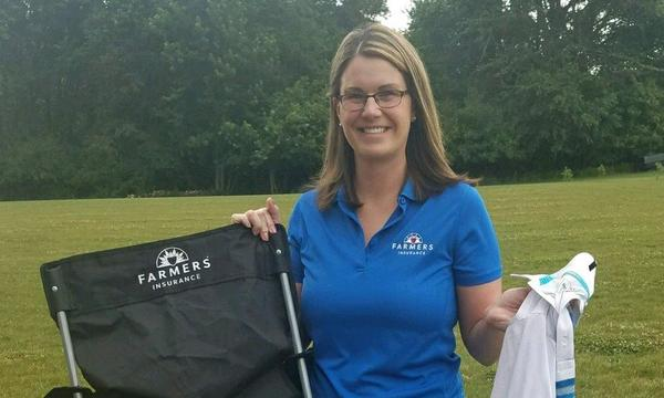 Gina participating in the UPS Golf Outing in June.
