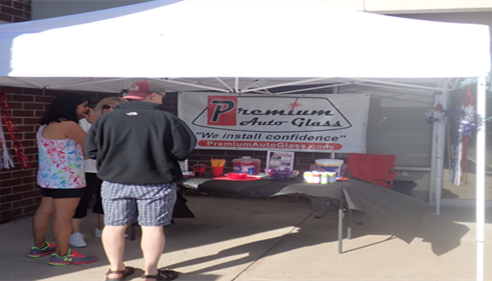 Premium Auto Glass providing services at Farmers Agent's customer appreciation event