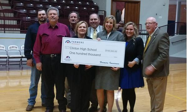 Sherrie Johnson with her $100,000 from Farmers Thank America's Teachers Dream Big grant