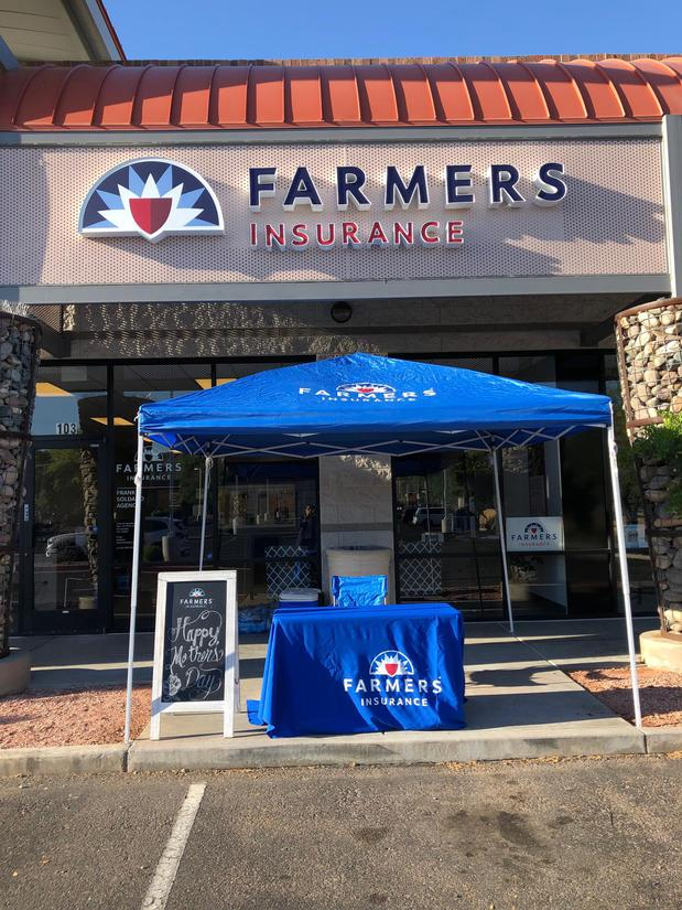 Photo of the Agency's store front with a Farmers tent set up for a Mothers Day event.