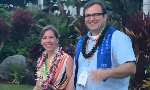 A couple with Hawaiian leis on.