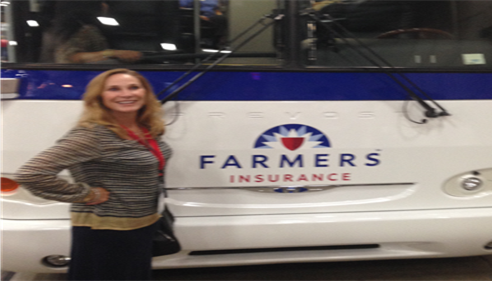 Standing in front of the Farmers® Bus!