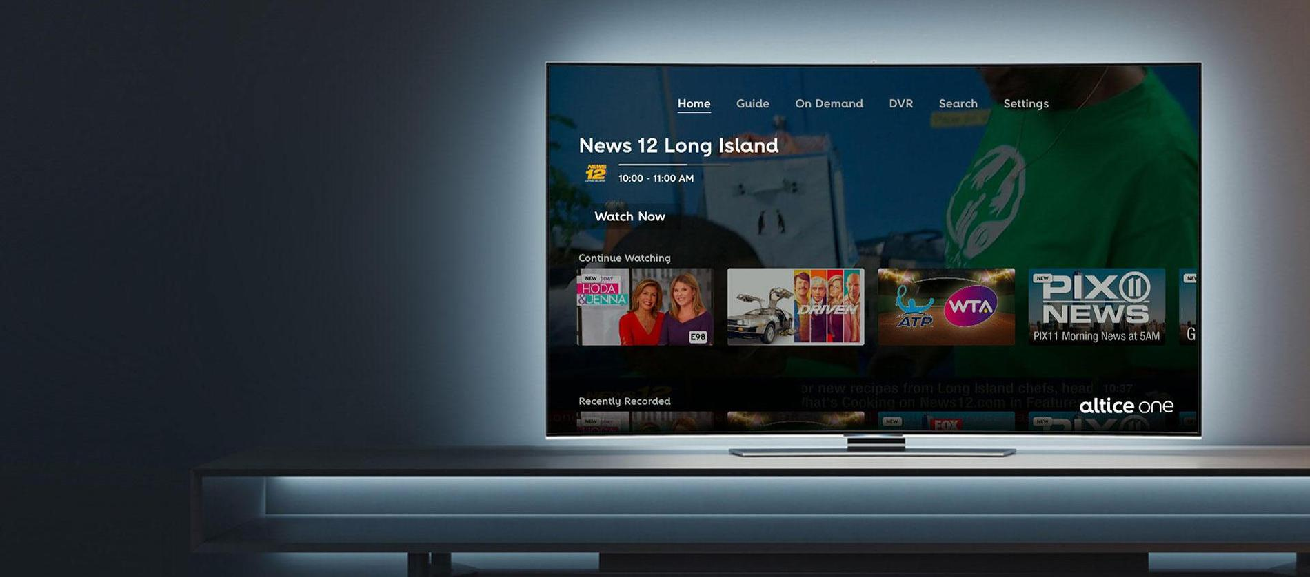 Photo of an Optimum TV connected screen in a living room, displaying viewing options