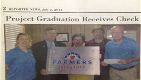 newspaper clipping of 3 men and 2 women holding a farmers sign.