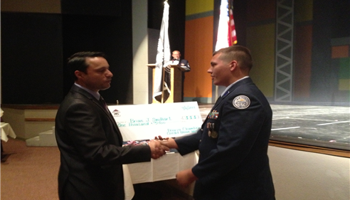 Presenting a Scholarship to a JROTC student