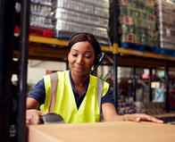 Woman worker at warehouse with barcode scanner