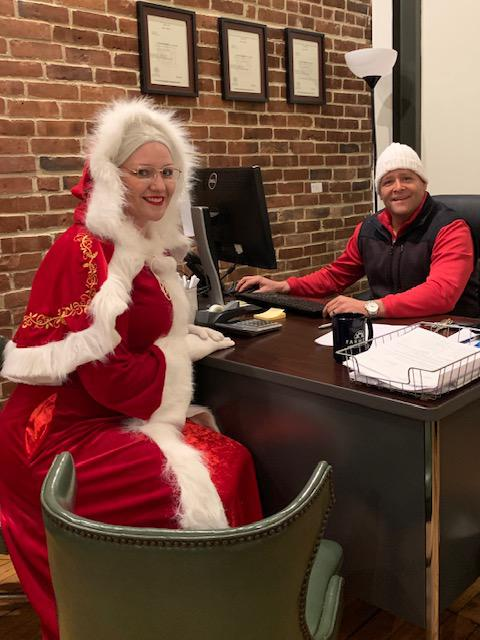 Mrs. Claus sitting across from Farmers agent
