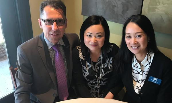 Agent Victoria Shi with two staff members