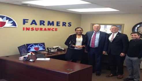 Staff members of The Wertzberger Agency posing with Jeff Dailey; Farmers® CEO.