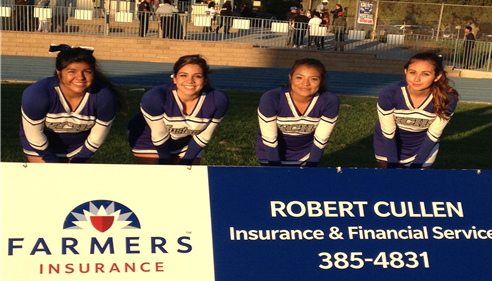 four female cheerleaders behind a Farmers Insurance sign for Agent Robert Cullen