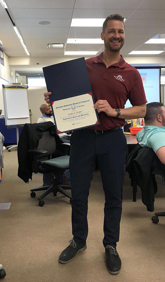 Man holding a certificate