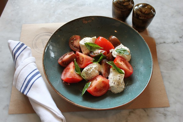 Mozzarella, tomato, and basil salad in a bowl