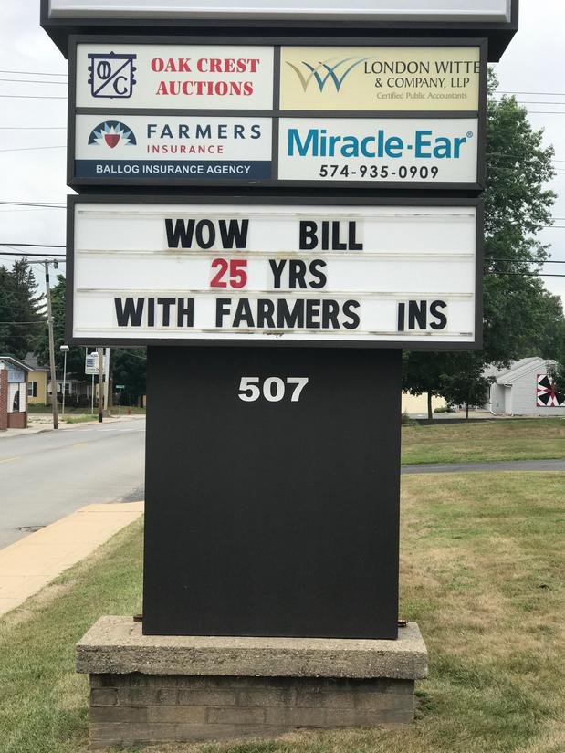 25 years with Farmers sign