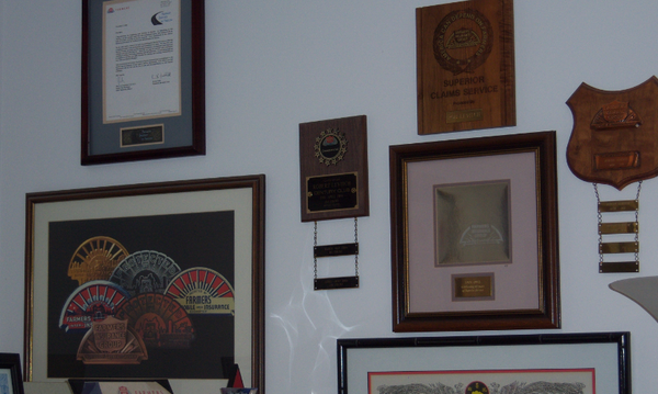 Some of the awards my agency has received displaying on our wall