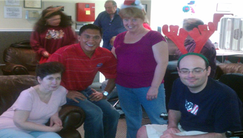 Agent Manuel Baniago giving back to the community at a special needs center.