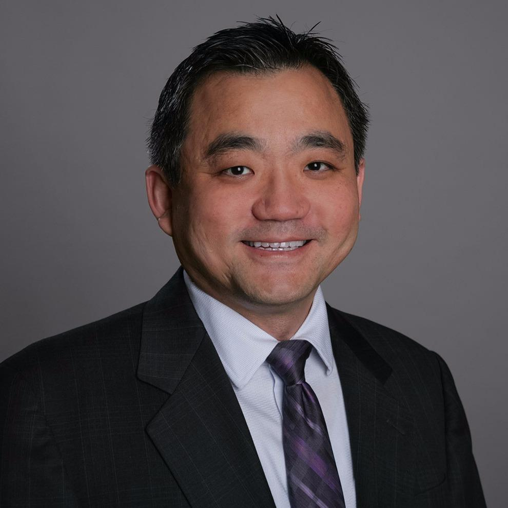 Headshot photo of Roger Chen