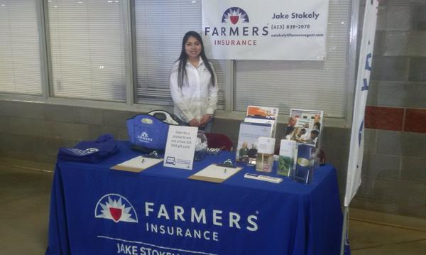 Woman standing behind a Farmers table