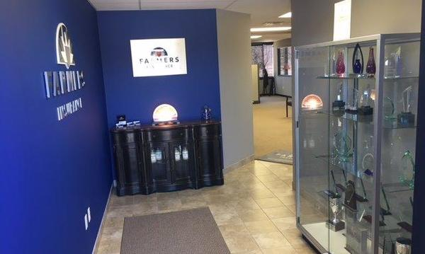 The entry way of The Matt North Agency, with a cabinet of awards.