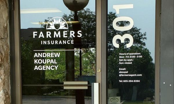A picture of the front door of a Farmers Insurance office