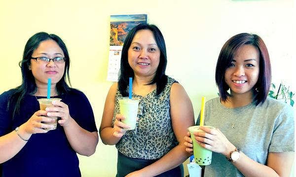 3 women standing with Bubble Tea drinks.